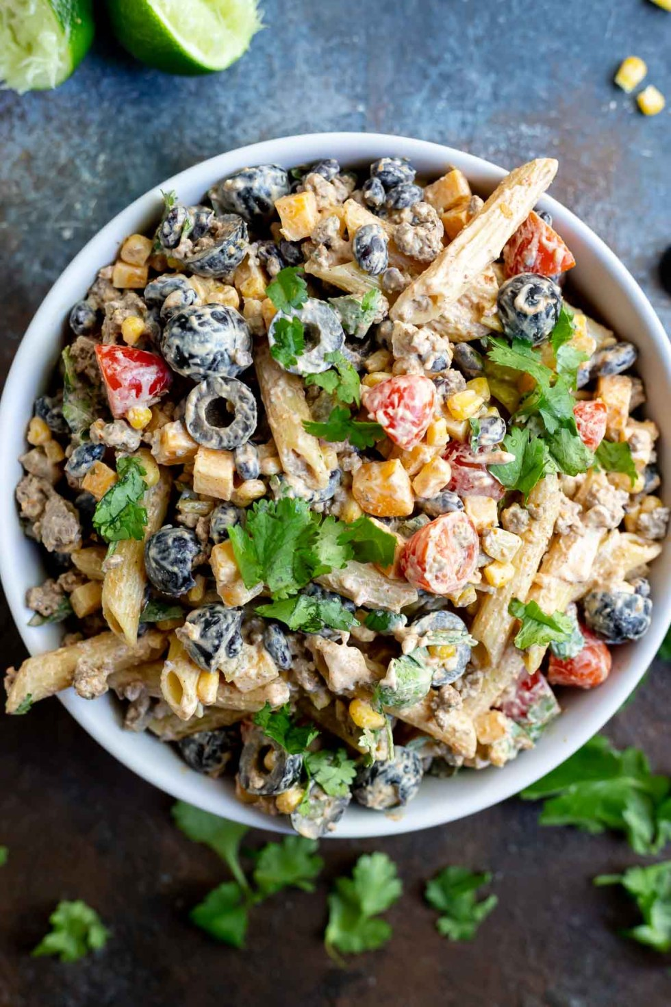 pasta salad in white serving bowl