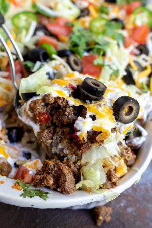 taco casserole being scooped with a serving spoon