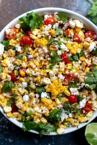 corn salad in a white serving bowl