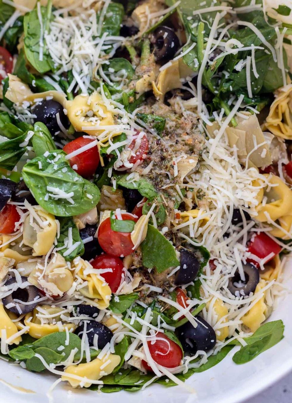 Italian pasta salad ingredients in white bowl