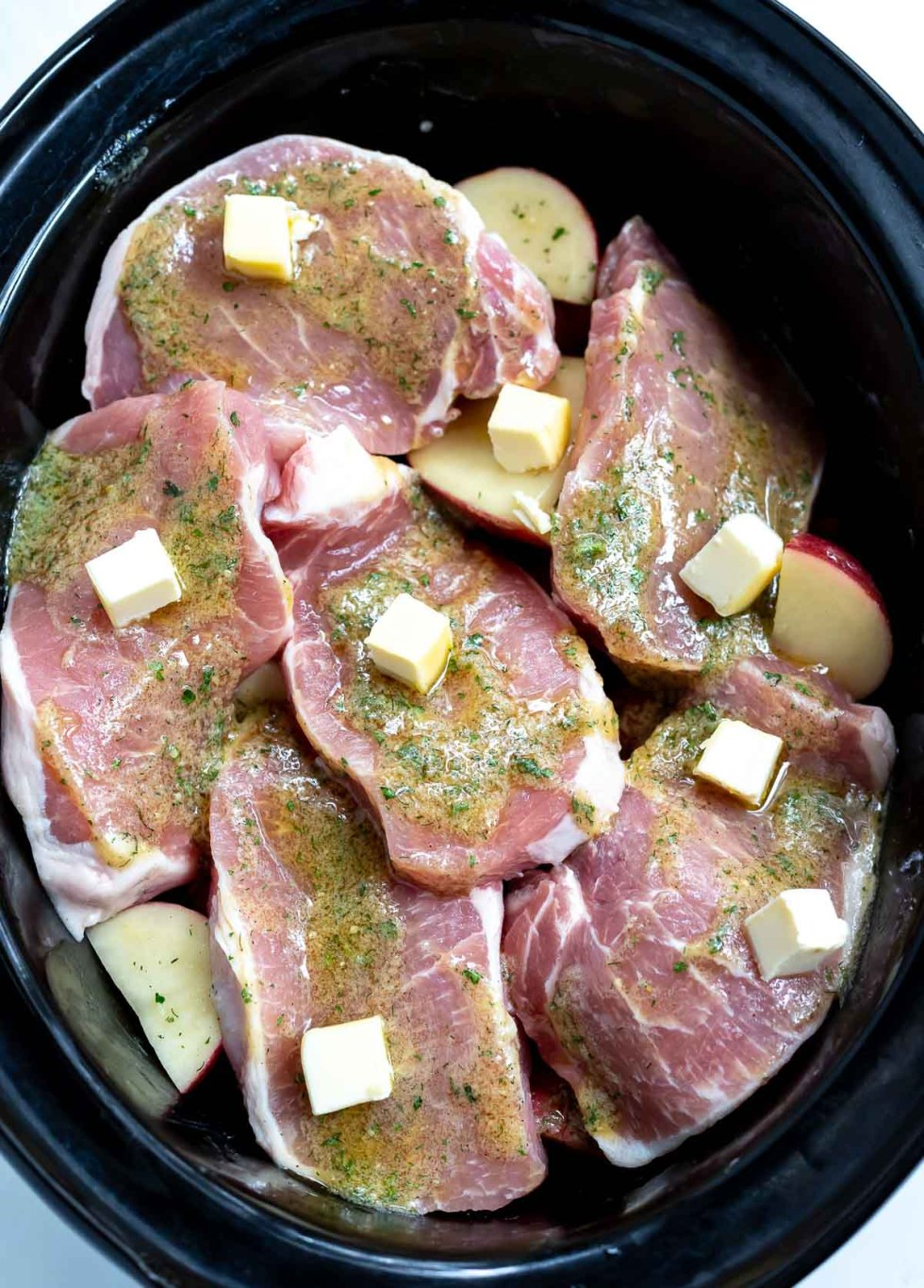raw pork chops, ranch season and butter in slow cooker