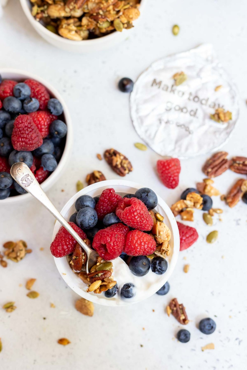 yogurt cup topped with granola and berries