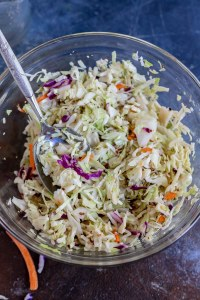 coleslaw in clear glass bowl
