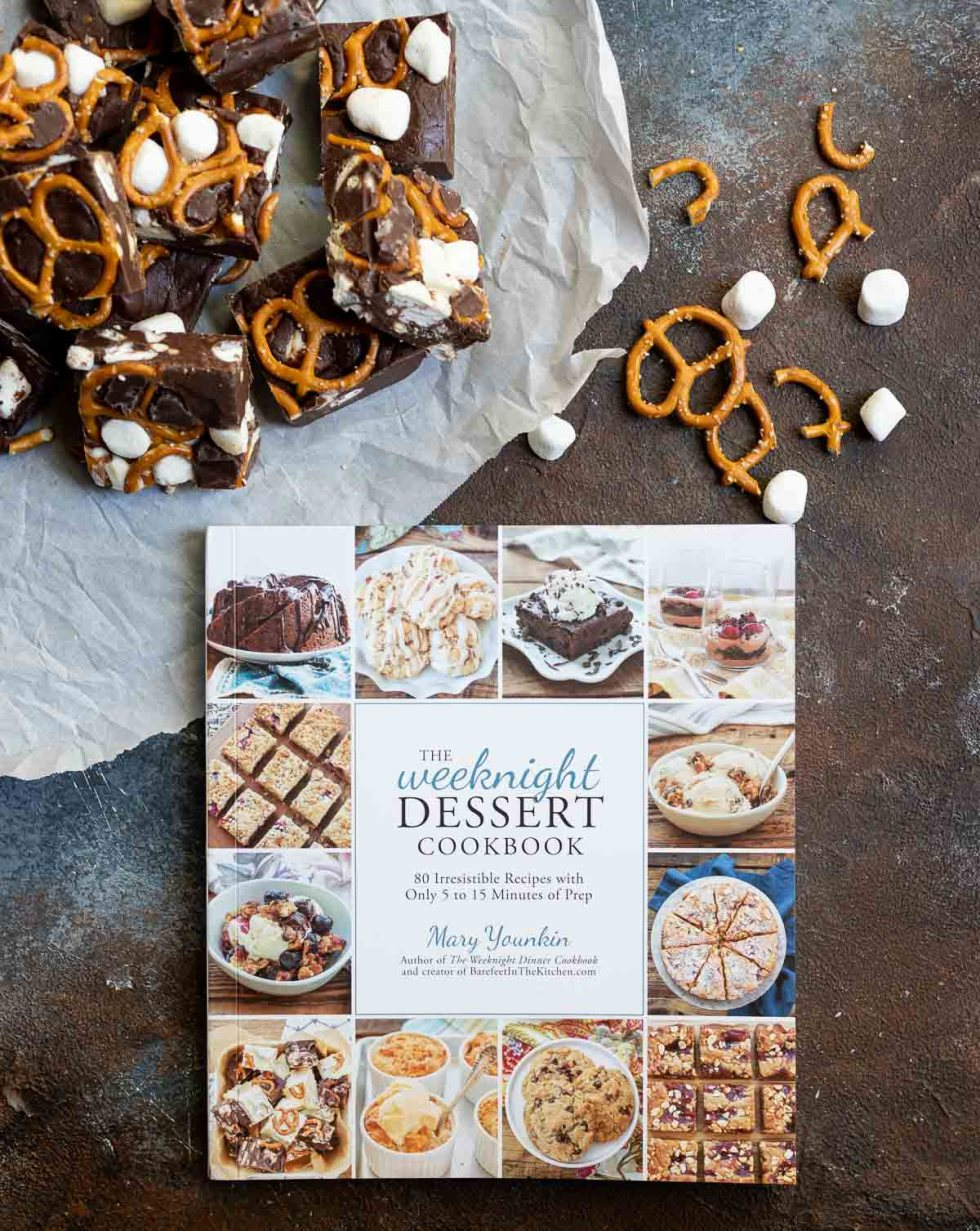 dessert cookbook next to fudge squares