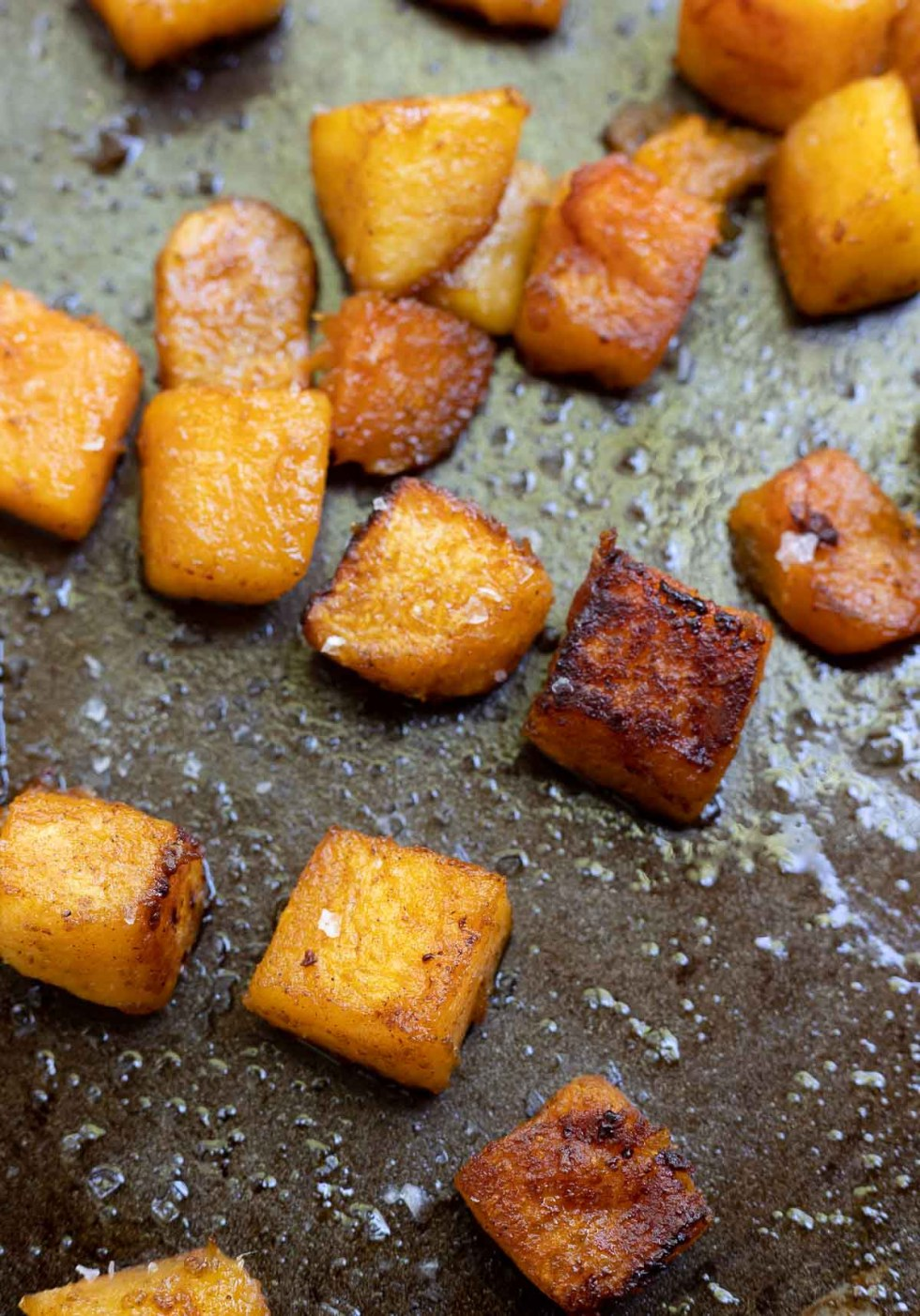 roasted brown sugar butternut squash on rimmed baking sheet