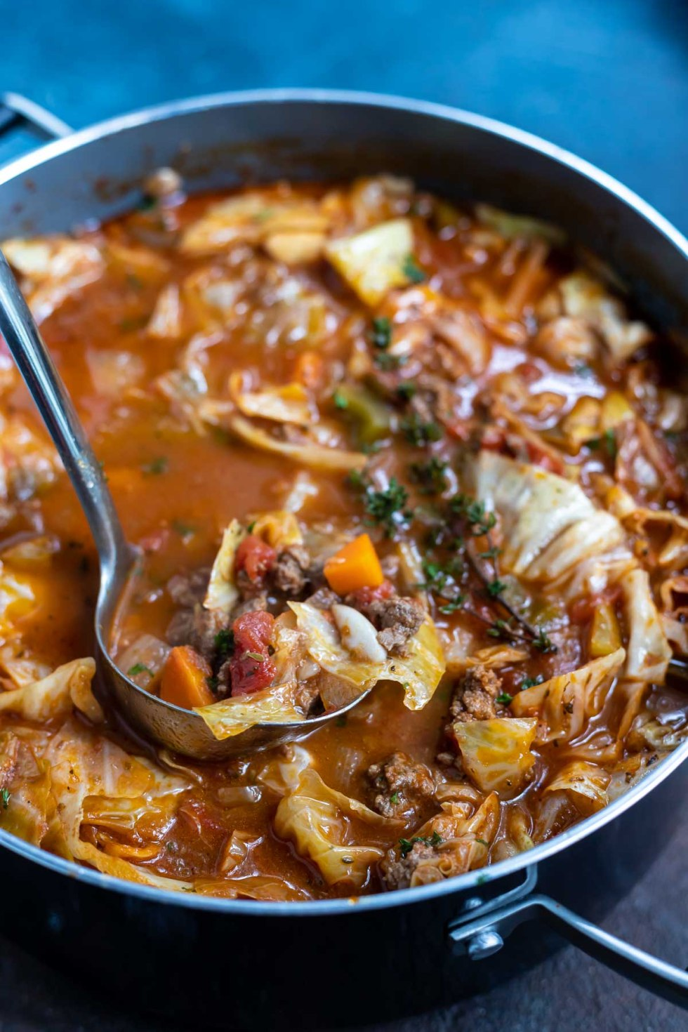 pot of cabbage soup with serving spoon
