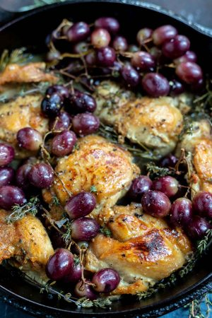 red grapes, chicken thighs and herbs