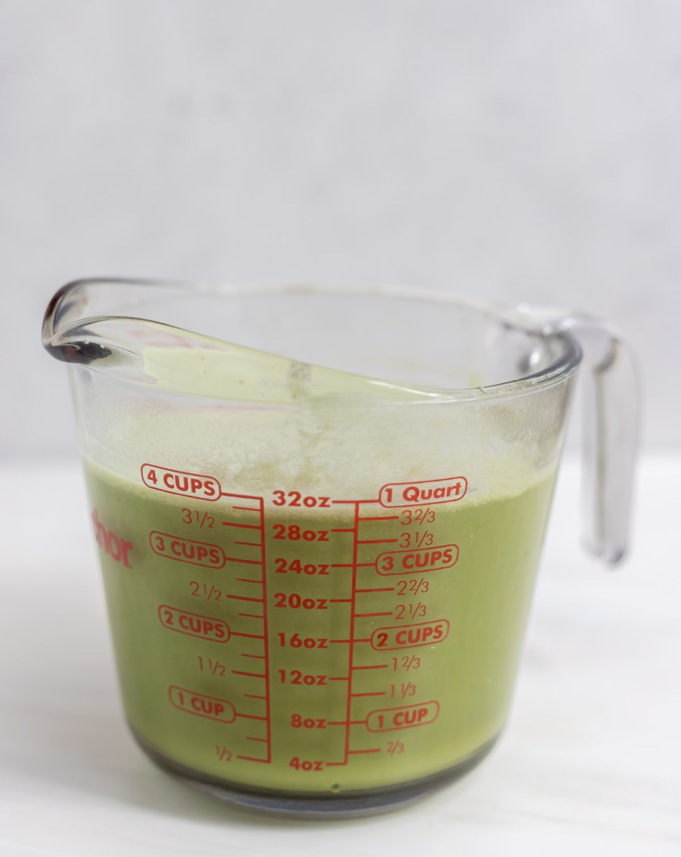 green drink in large measuring cup