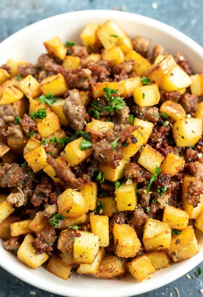 potato and sausage hash served in white bowl