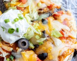prepared Mexican pizza topped with sour cream and sliced green onions