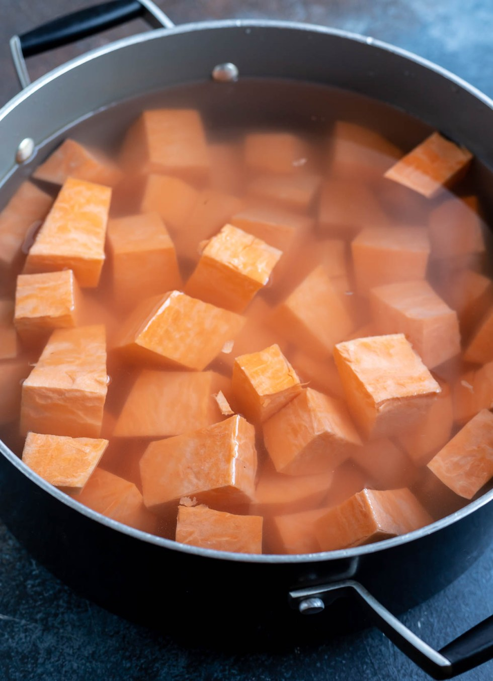 sweet potato cubes and water in pot