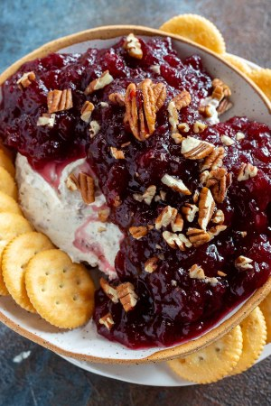 creamy dip topped with cranberry sauce served with ritz crackers