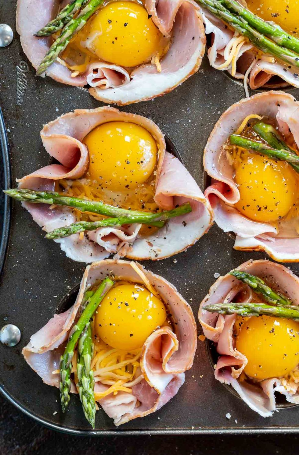uncooked egg cups in muffin tin