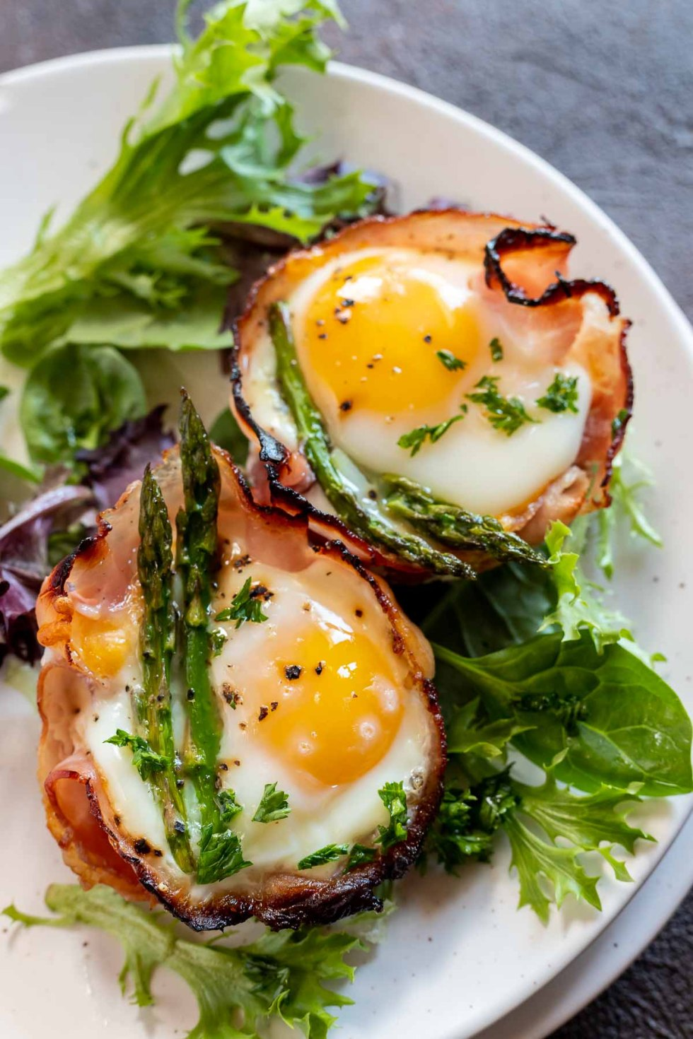 cooked egg cups served on white plate
