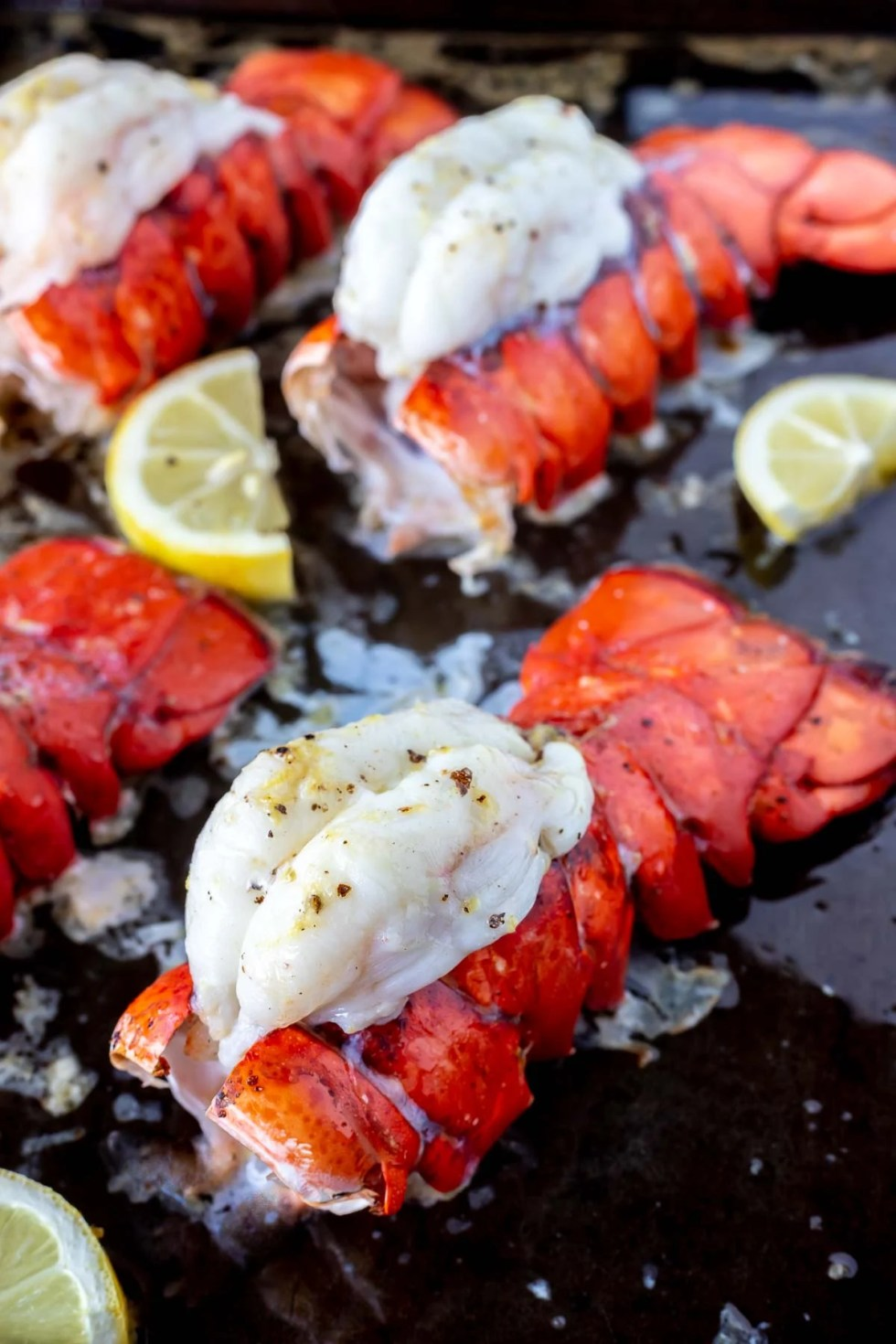 baked lobster tails on rimmed baking sheet