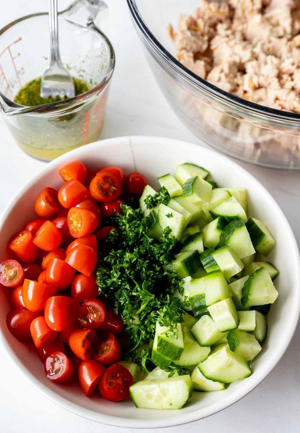 tuna salad ingredients in white bowl