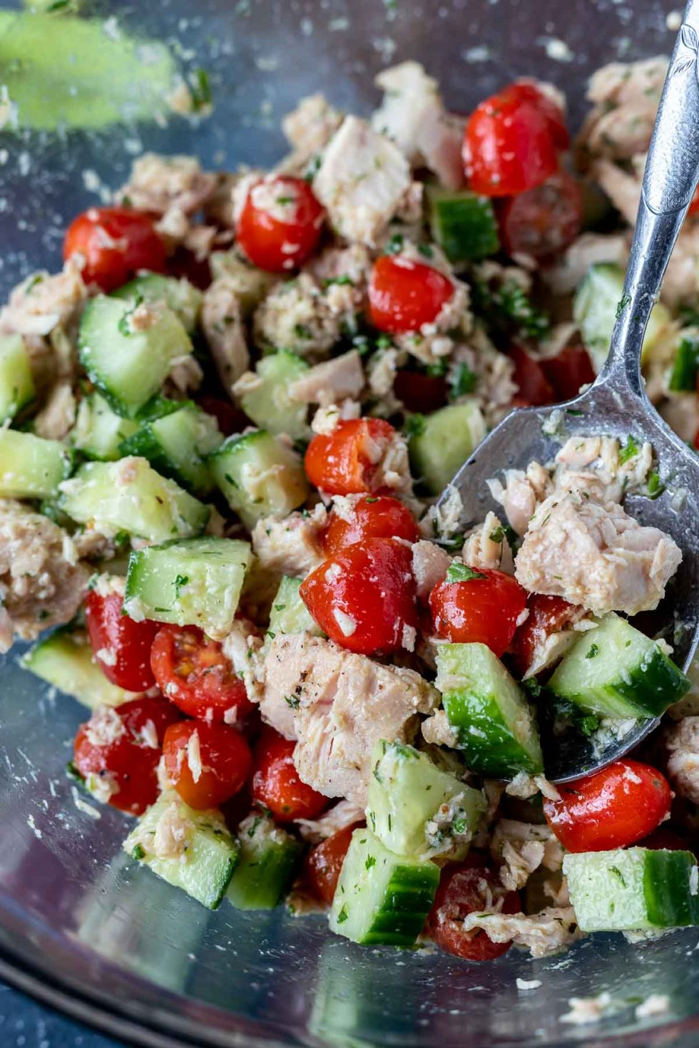 serving spoon scooping tuna salad from bowl