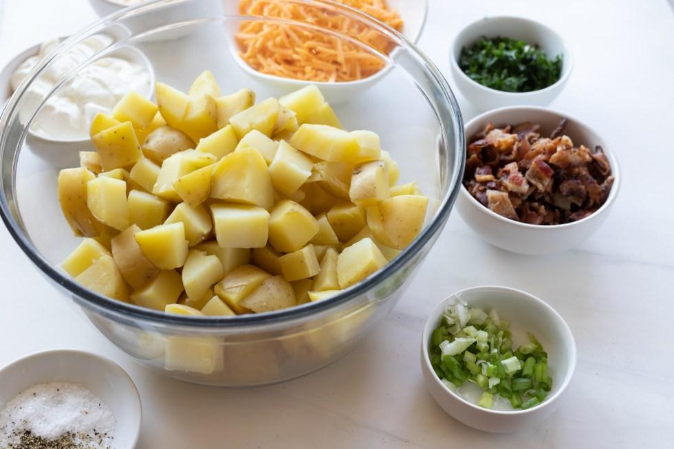 potato salad ingredients in bowls