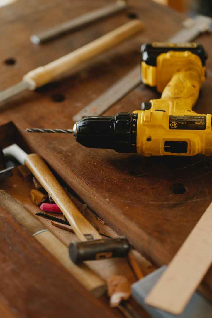 modern convenient screwdriver drill among tools for carpentry