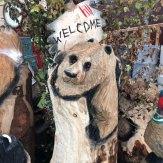 welcome bear wood carving woodbank nurseries