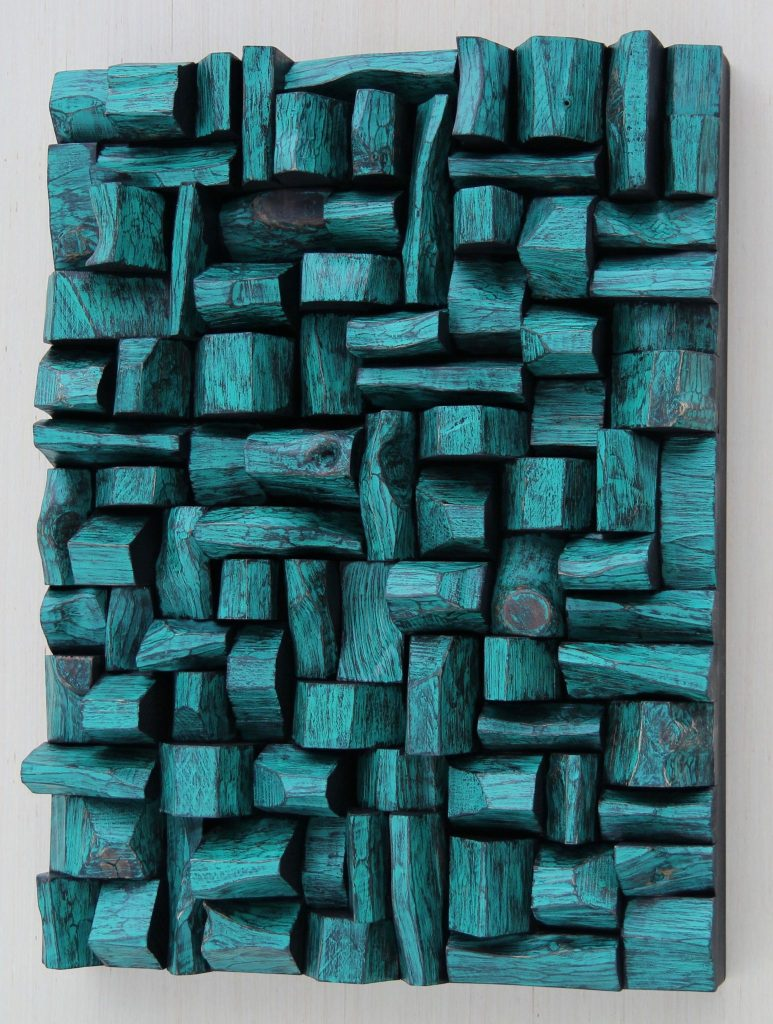 Outstanding wood blocks assemblage, the unique composition of richly textured surfaces, intricate shape formations, and vibrant and radiant color
