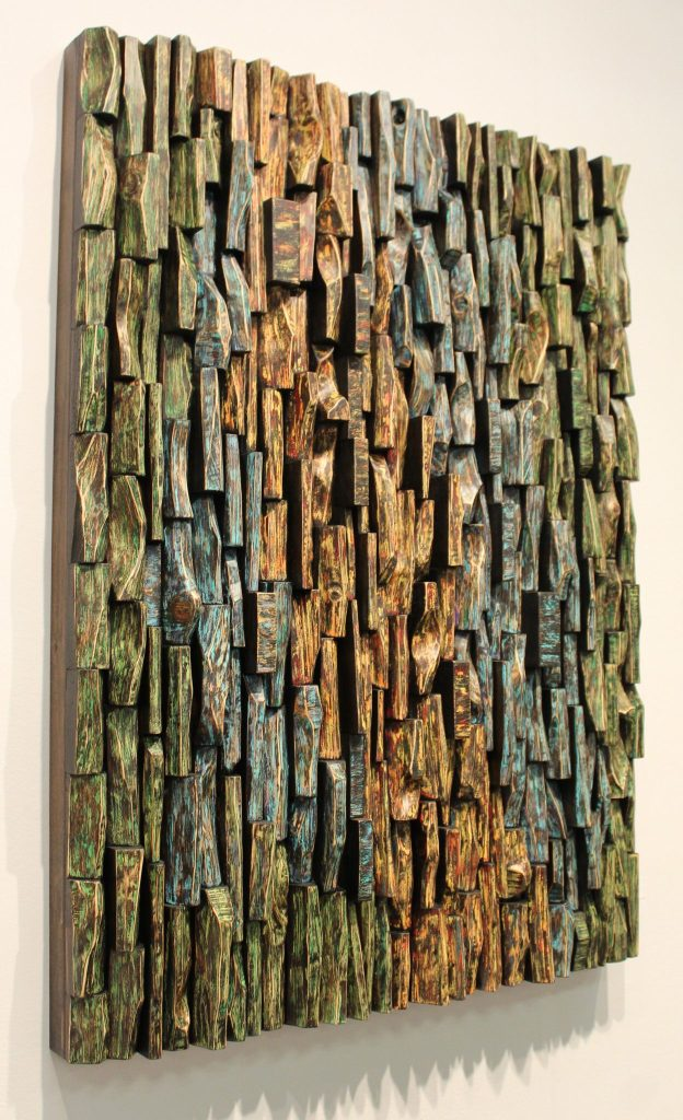 Wood collage sculpture with a unique textured surface and intricate wood blocks shapes