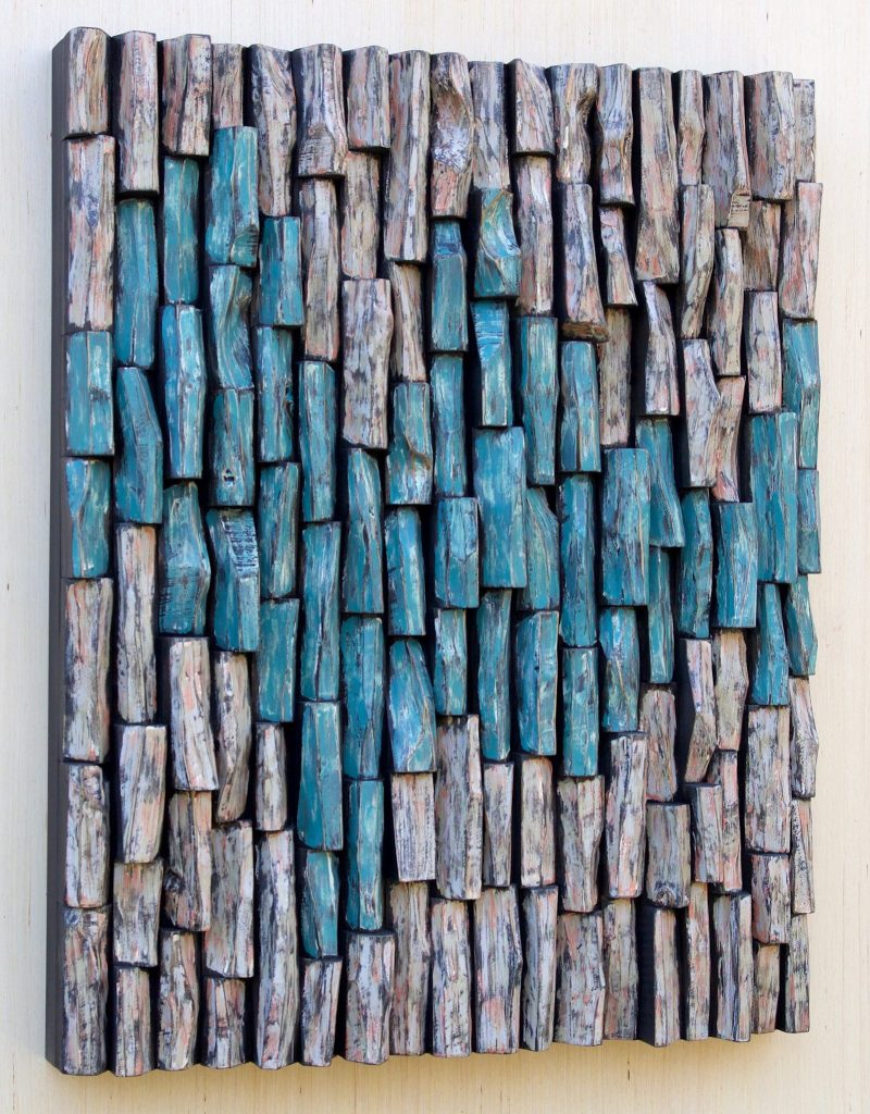 Stunning wood assemblage by Canadian artist Olga Oreshyna combines tranquil balance and harmony of intriguing shape formations, and vibrant and radiant color