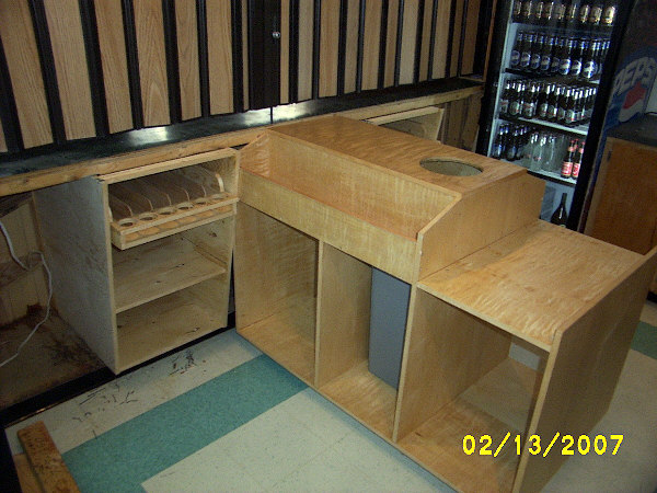 Installed behind bar cabinets.