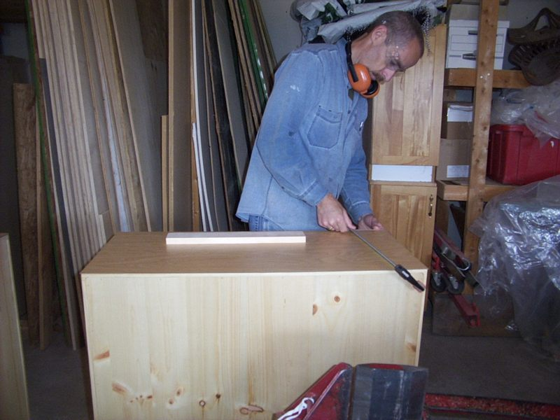 Attaching the countertops.