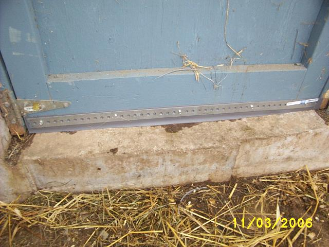 Sheep barn door sweep.