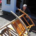 Refinishing a rocking chair.