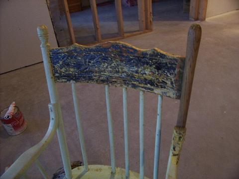 Stripping an antique chair.