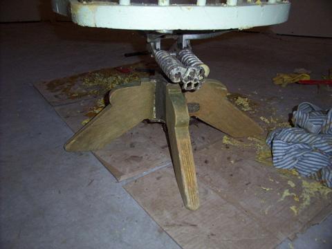 Stripping an antique chair.