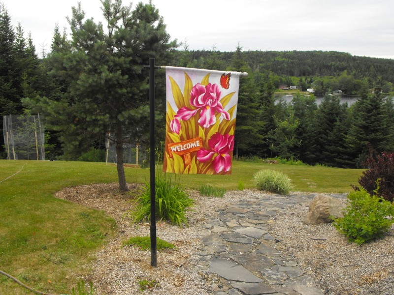 garden,landscaping,welcome sign flag pole