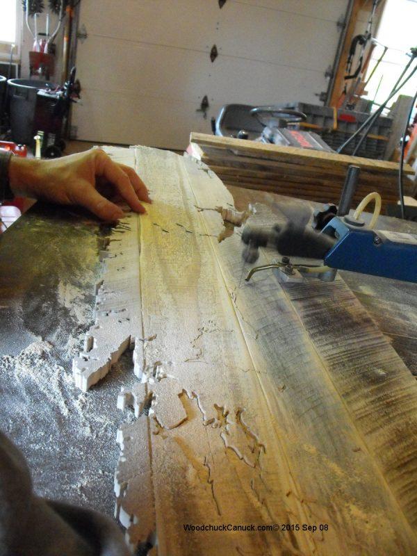 scrolling a rustic wooden map of Nova Scotia