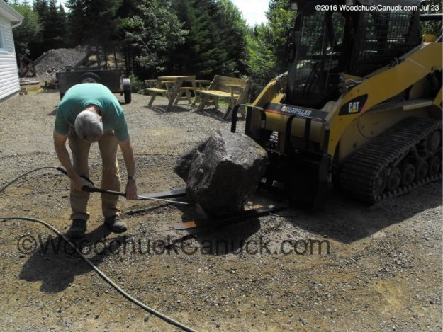 large rocks,landscaping,skidsteer,CAT257B2