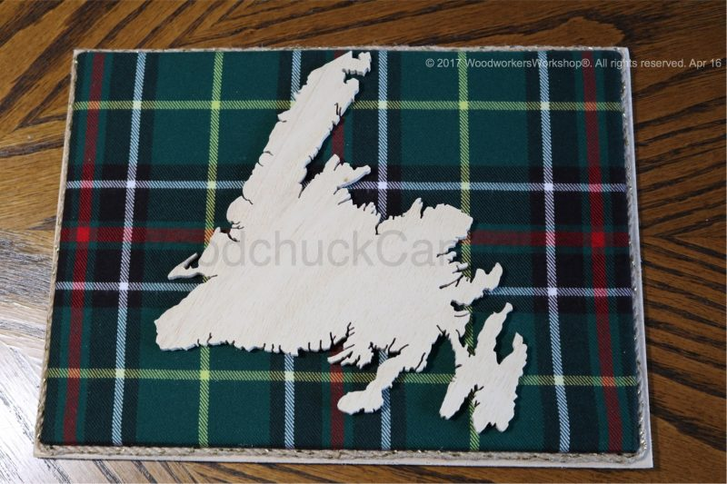Wood map of Newfoundland with tartan background, cartography,St. John's,Stephenville,Baie Verte,Gander,Grand Falls,St. Anthony,Carbonear,Clarenville