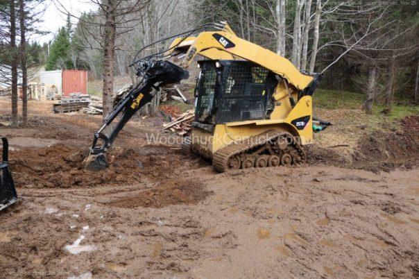 skidsteer,mud,clearing land