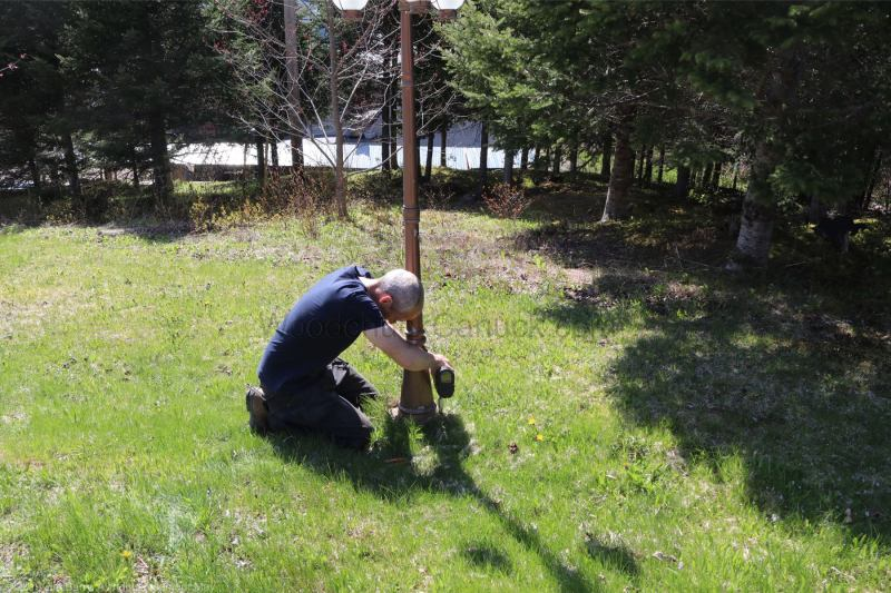 building driveway lamp posts with solar lighting.