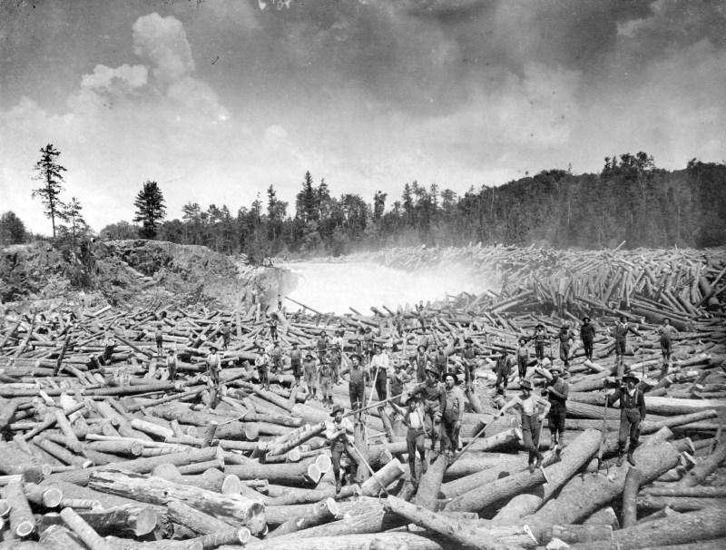 1910-14-Crow's Nest Pass Lumer Co. lumberjacks on a log jam in Bull River.