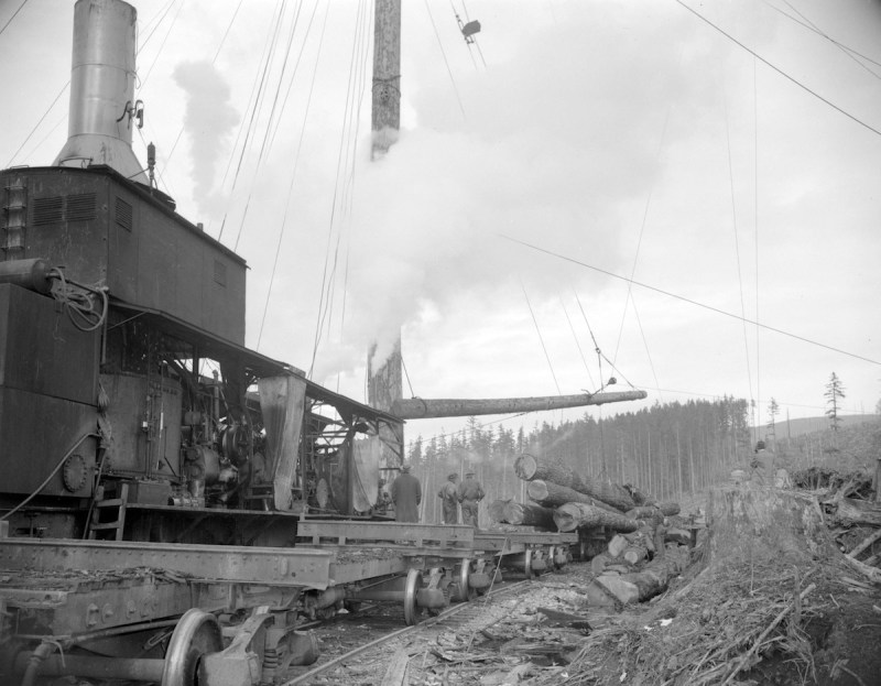 1940s Logs being loaded off rail cars at the H.R. MacMillan Co. sawmill