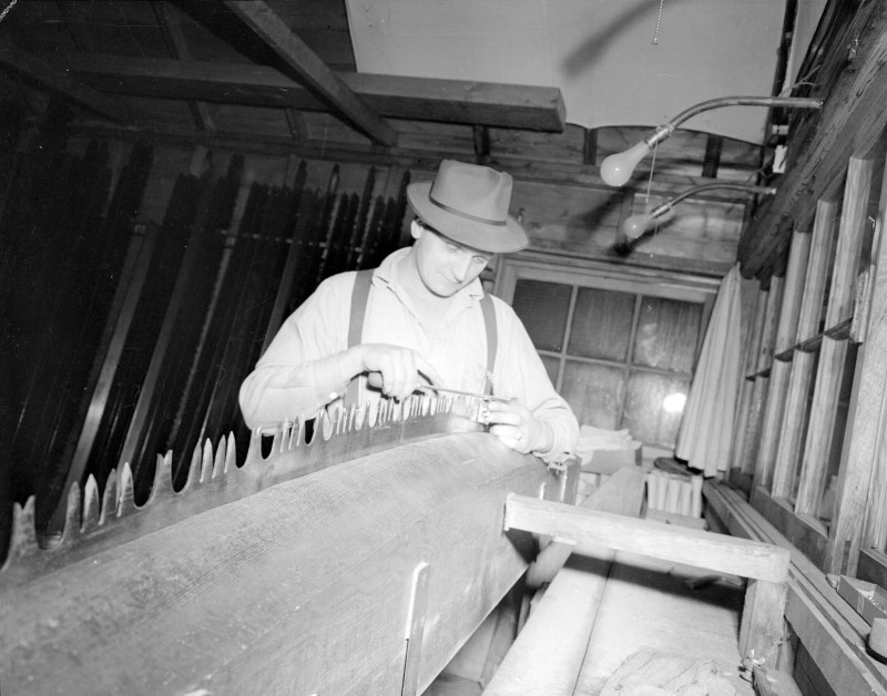 1945 Filing a large saw blade in the saw shop