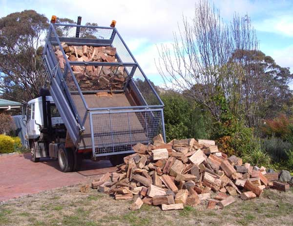 Firewood truck with dividers.