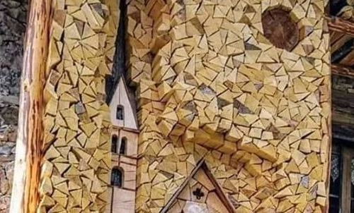 Wood pile art of a church.