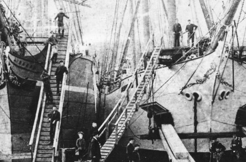 close up 1890 Lumber ships loading at Hastings Sawmill.