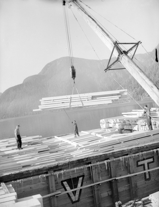 1944 Sitka Spruce lumber being loaded onto a barge at Pacific Mills.
