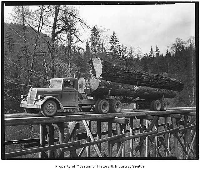 1937 Kenworth Logging truck crossing bridge.