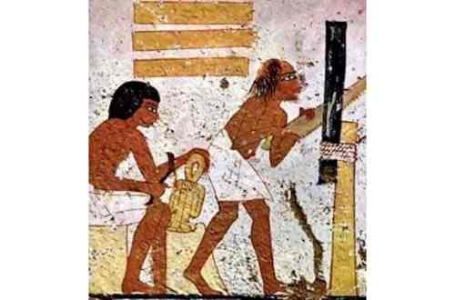 Egyptian carpenter making lumber.