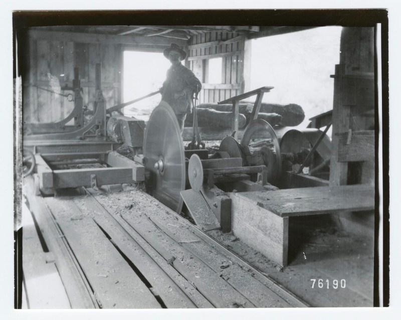 1900 single man operating sawmill.