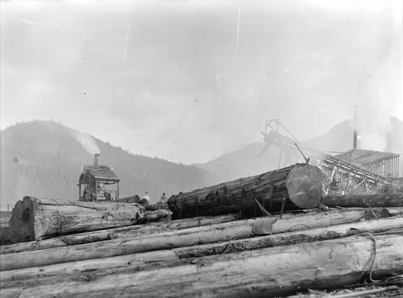 1900s Log deck and steam donkey machinery at Fraser Valley Sawmill, BC.